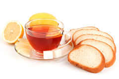 Glass cup of tea with slices of white bread Royalty Free Stock Photos