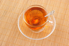 Glass cup of tea with spoon Stock Image
