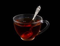 Glass cup of tea with spoon Stock Photo
