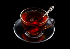 Glass cup of tea with spoon isolated Royalty Free Stock Photos