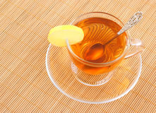 Glass cup of tea with spoon and lemon Royalty Free Stock Image