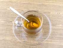 Glass cup tea with spoon Stock Photos
