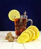 Glass cup of tea with sugar and lemon Stock Photography