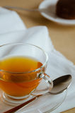 Glass Cup of Tea for Tea Break Time. Glass cup of tea and chocolate cake for tea break Royalty Free Stock Image