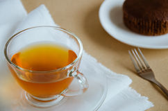 Glass Cup of Tea for Tea Break Time. Glass cup of tea and chocolate cake for tea break Stock Photography