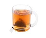 Glass cup of tea with teabag isolated Royalty Free Stock Photos
