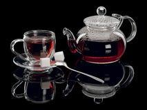 Glass a cup with tea and a teapot Royalty Free Stock Photography