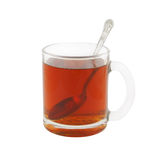 Glass cup of tea with teaspoon isolated Royalty Free Stock Images