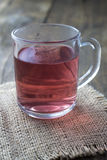 Glass cup of tea on wood background Stock Images