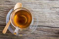 Glass cup of tea. On wood background, top view Royalty Free Stock Photography