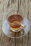Glass cup of tea. On wood background, top view Royalty Free Stock Photo