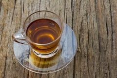 Glass cup of tea. On wood background, top view Stock Image