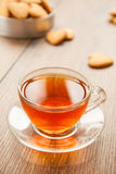 Glass cup of tea on a wooden table. Stock Photo
