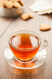 Glass cup of tea on a wooden table. Royalty Free Stock Image