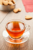 Glass cup of tea on a wooden table. Stock Photos