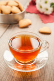Glass cup of tea on a wooden table. Stock Image