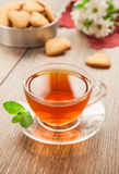 Glass cup of tea on a wooden table. Royalty Free Stock Photos