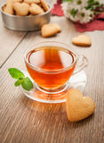 Glass cup of tea on a wooden table. Royalty Free Stock Photo