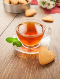 Glass cup of tea on a wooden table. Stock Photography