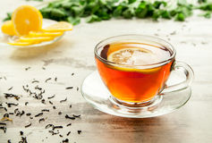 Glass cup of tea on a wooden table. Royalty Free Stock Photography