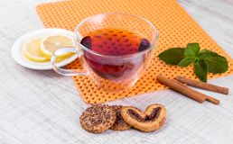 Glass cup of tea on a wooden table Royalty Free Stock Photography