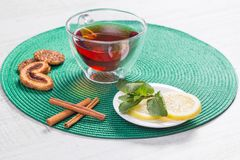 Glass cup of tea on a wooden table Royalty Free Stock Images