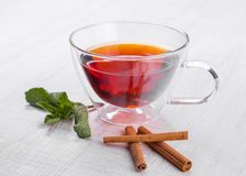 Glass cup of tea on a wooden table Royalty Free Stock Image
