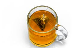 Glass cup with teabag, black tea. Isolated on a white. Background royalty free stock photos