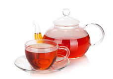 Glass cup and teapot of black tea Stock Images