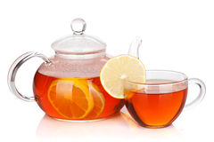 Glass cup and teapot of black tea with lemon. Isolated on white background Stock Photos