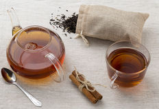 Glass cup and teapot freshly brewed black tea Stock Photo
