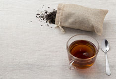 Glass cup and teapot freshly brewed black tea Stock Images