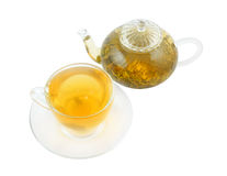 Glass cup and teapot with green tea Royalty Free Stock Image