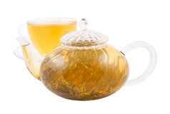 Glass cup and teapot with green tea Stock Photography