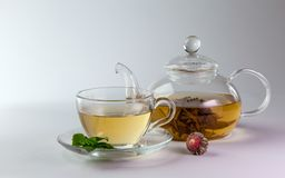 Glass cup and teapot of green tea Stock Image