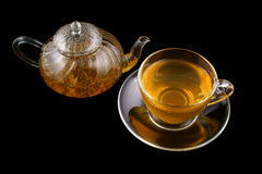 Glass cup and teapot with green tea isolated Stock Photo
