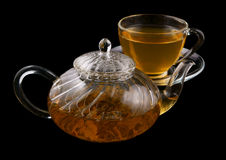 Glass cup and teapot with green tea isolated Royalty Free Stock Photos