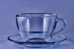 Glass cup with water on a blue background stock images