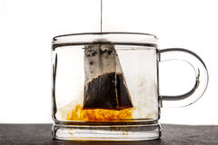Glass cup with water and tea bag  horizontal Royalty Free Stock Photo