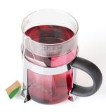 Glass cup wirh teabag. Hibiscus tea Royalty Free Stock Image