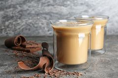 Glass cups with iced coffee. On gray table stock photography