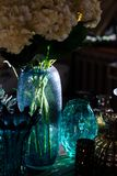 Glass cups and vases in the sun stock image