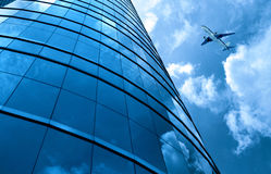 Glass curtain wall and aircraft Royalty Free Stock Photo