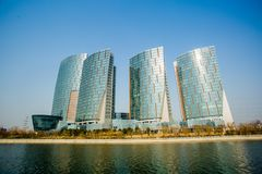 Glass curtain wall construction. The glass curtain wall buildings, blue skyn Royalty Free Stock Photo