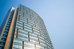 Glass curtain wall construction. The glass curtain wall buildings, blue skyn Royalty Free Stock Photos