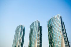 Glass curtain wall construction. The glass curtain wall buildings, blue sky Stock Photography