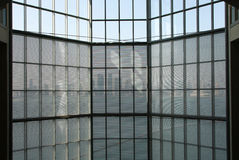 Glass curtain wall and qatar skyline from inside Qatar Museum Stock Photo
