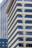 Glass and Curved Stone Office Building Royalty Free Stock Photos