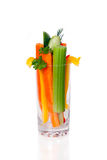 The glass with cut fresh vegetables Stock Images