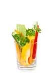 The glass with cut fresh vegetables Royalty Free Stock Images